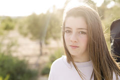 Portrait of a 15 year old teenage girl. Photographed in backlight Stock Photos