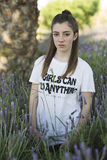 Portrait of a 15 year old teenage girl. Photographed among lavender plants Royalty Free Stock Photo