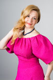 Portrait of a 39 year old woman in pink dress Stock Image