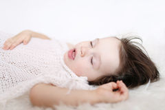 Portrait of 2 years child sleeping on white fur plaid Stock Photography