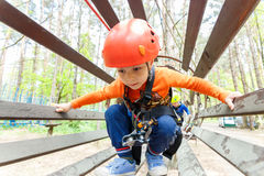 Portrait of 3 years old boy wearing helmet and climbing Stock Images