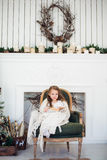Portrait of 7 years old child reading book at home on christmas Stock Photography