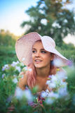 Portrait of a yong woman in a hat on nature Royalty Free Stock Photography