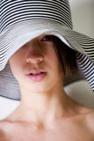 Portrait of you multi etnic girl with summer hat Stock Photos