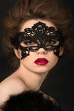 Portrait of young adorable woman in black party mask. Portrait of young adorable woman wearing black party mask Royalty Free Stock Photos