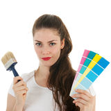 Portrait young adult with brush and samples Royalty Free Stock Image