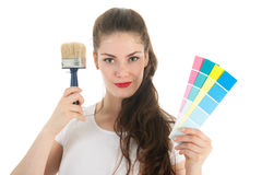 Portrait young adult with brush and samples Stock Image