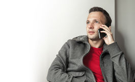 Portrait of young adult Caucasian man talking on mobile phone Royalty Free Stock Images