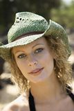 Portrait of young-adult female in hat. Royalty Free Stock Image