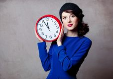 Portrait of young adult girl with big clock Stock Photo
