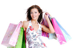 Portrait young adult girl with colored bags Stock Photography