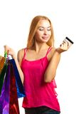 Portrait young adult girl with colored bags hold credit card Stock Images
