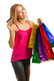 Portrait young adult girl with colored bags hold credit card Royalty Free Stock Image