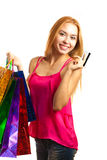 Portrait young adult girl with colored bags hold credit card Royalty Free Stock Images