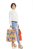 Portrait young adult girl with colored bags Royalty Free Stock Photos