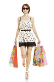 Portrait young adult girl with colored bags Royalty Free Stock Photo