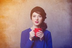 Portrait of young adult girl with cup of coffee or tea Stock Photography