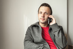 Portrait of young adult man talking on mobile phone Royalty Free Stock Photos