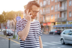 Portrait of young adult man talking on phone Stock Photo