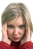 Portrait of a young adult woman suffering from headache Royalty Free Stock Image