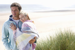 Portrait of young affectionate couple at beach Stock Photos