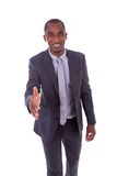 Portrait of a young African American business man greeting with Royalty Free Stock Image