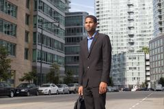 Young African American man standing on the street. Portrait of Young African American business man looking sharp and confident, photographed in September 2017 Stock Photo