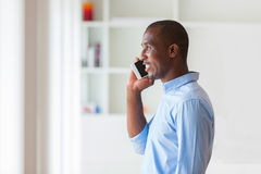 Portrait of a young African American business man using a mobile. Phone - Black people Royalty Free Stock Image