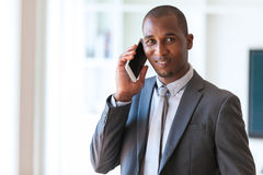 Portrait of a young African American business man using a mobile. Phone - Black people Stock Photos