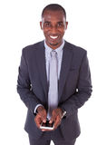 Portrait of a young African American business man using a mobile Royalty Free Stock Image