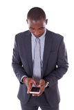 Portrait of a young African American business man using a mobile Stock Image