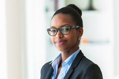 Portrait of a young African American business woman - Black peop Stock Image