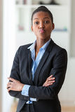 Portrait of a young African American business woman joking  - Bl Stock Photo