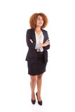 Portrait of a young african american business woman looking up -. Portrait of a young african american business woman looking up , isolated on white background Royalty Free Stock Image