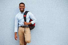 Portrait of young African American man against a grey wall Royalty Free Stock Photos