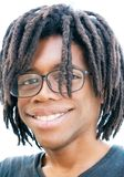 Portrait of a young african american man with enlarged eyes and. With dreadlocks and a funny expression, shot on a white background Stock Photography