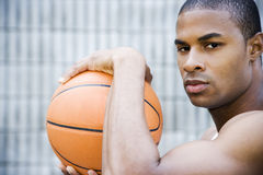 Portrait of a young African American man holding a basketball. Stock Photography