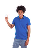 Portrait of a young african american man holding something Royalty Free Stock Photos