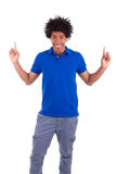 Portrait of a young african american man holding something Royalty Free Stock Image