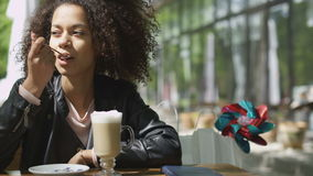 Portrait of young african american woman enjoying cup of coffee at cafe. stock footage