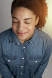 Portrait of young African American woman. Indoors royalty free stock image