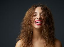 Portrait of a young african american woman laughing Stock Image
