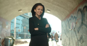 Portrait of young African American woman looking to a camera, outdoors. Portrait of a young black woman in urban background Royalty Free Stock Photo