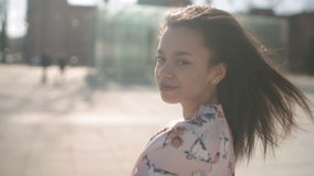 Portrait of young African American woman posing to a camera, outdoors. stock footage