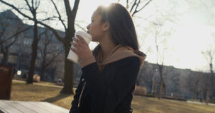 Portrait of young African American woman with a take away coffee, outdoors. Stock Photos