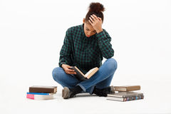 Portrait of young african girl with books over white background. Stock Images