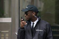 Security Guard Talking On Walkie-Talkie. Portrait Of Young African Male Security Guard Talking On Walkie-Talkie stock photos