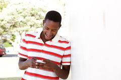 Young african man using cell phone outside Stock Photos