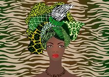Portrait of the young African woman in a colorful turban. Wrap Afro fashion, Ankara, Kente, kitenge, African women dresses. Nigerian style, Ghanaian fashion Stock Images