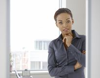 Portrait of young afro-american woman in office Royalty Free Stock Photo